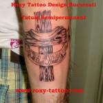 cruce semipermanent tatuaje Roxy Tattoo